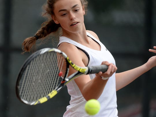 Richmond's Cami Jones returns the ball in no. 1 singles