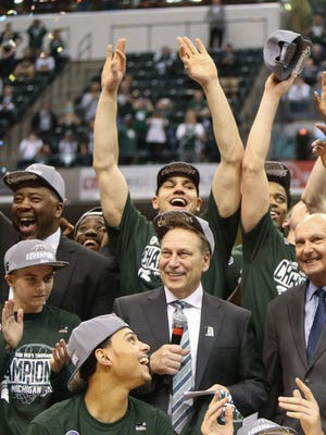 Tom Izzo talks to fans as the Michigan State Spartans raise the Big Ten Tournament trophy after beating the Purdue Boilermakers, 66-62, on Sunday, March 13, 2016 at Bankers Life Fieldhouse in Indianapolis, Indiana.