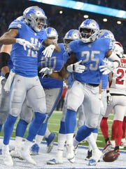 Theo Riddick (25) celebrates his touchdown against the Cardinals with Kenny Golladay in the third quarter of the Lions' 35-23 win Sunday, Sept. 10, 2017 at Ford Field.