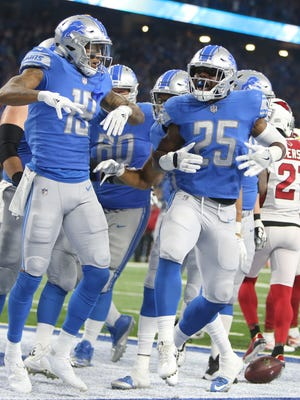 Even the running backs, such as Theo Riddick here, are getting in on the TD celebration action.