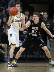 Clarkston guard Foster Loyer passes against Holland