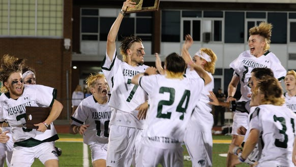 Pleasantville players celebrate after beating Westlake