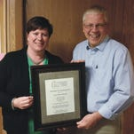 Fricke Printing Service Inc. vice president Amy Fricke-Weigel, left, has been selected as this year's Clipper City Chordsmen Harmony Award recipient.