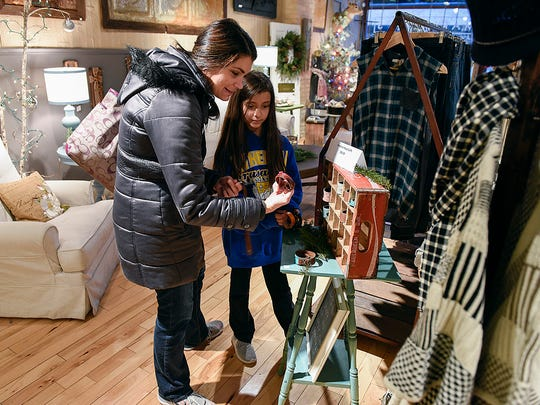 Amanda Anderson of St. Augusta and her daughter Isabelle, 10, look for a gift at Marishka's Shoppe, which has women's clothing, jewelry and home decor items.
