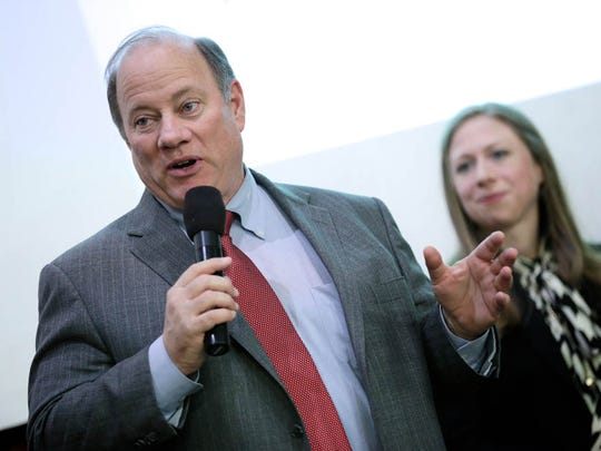 Mayor Mike Duggan talks to students during Chelsea Clinton visit to YouthVille Center.