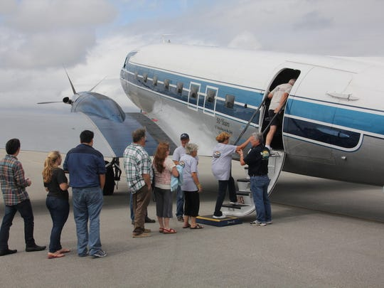 Families take a flight with Missionary Flights International during its 2015 Family Fun Day.