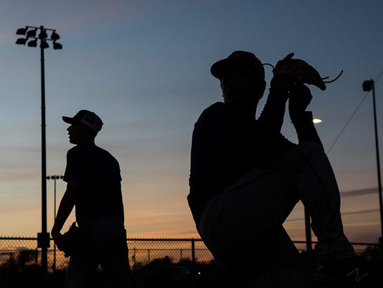Moody pitchers throw in the dugout during practice