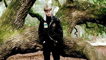 In a self-portrait taken shortly before his attack on Emanuel African Methodist Episcopal Church, Dylann Roof poses in front of the Angel Oak near Charleston, a tree believed to be hundreds of years old. The patches on his jacket are flags of the defunct states of Rhodesia and apartheid South Africa, popular symbols among white supremacists.
