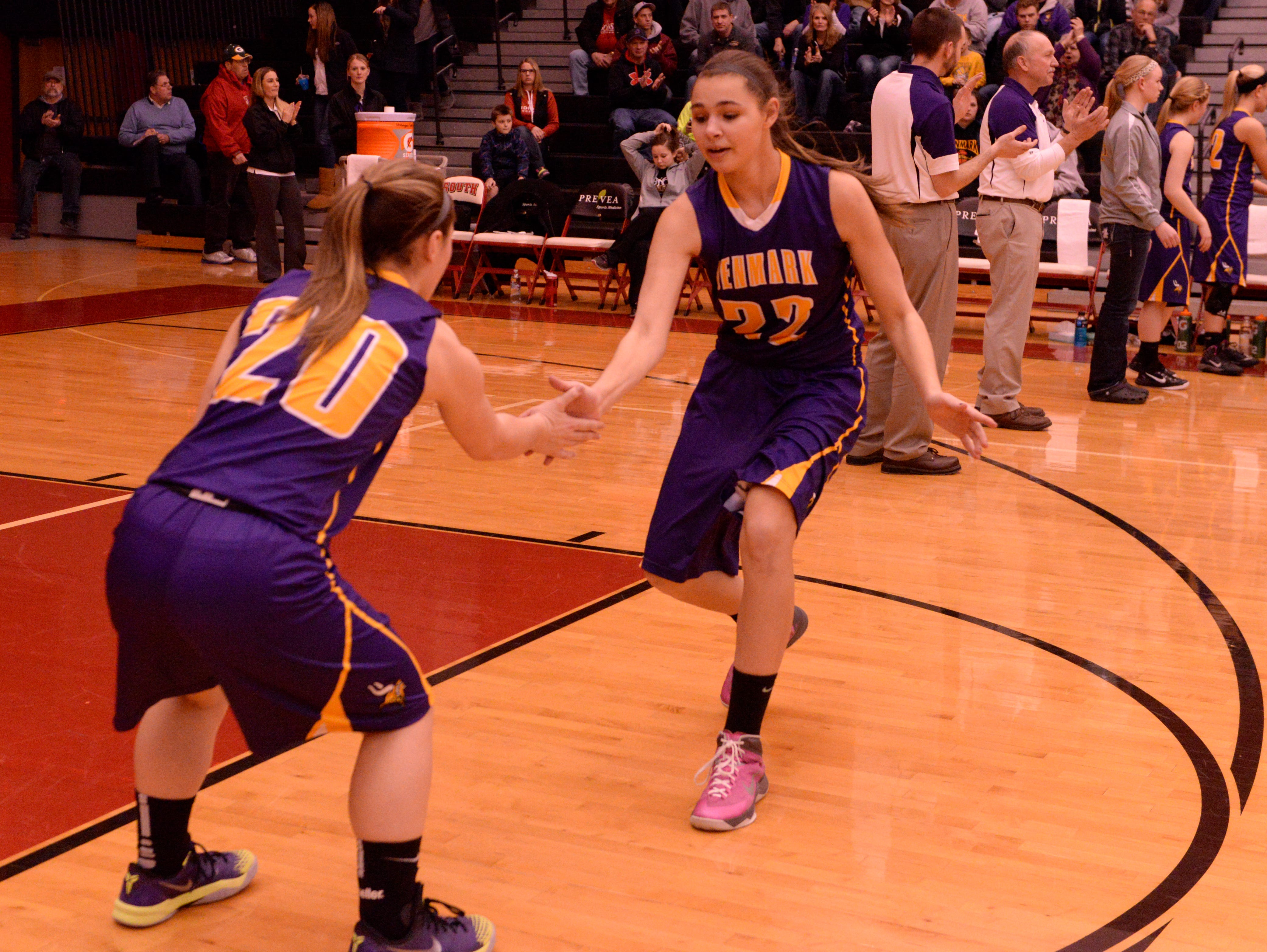 Ashley Leiterman (No. 22) and Leah Hansen (No. 20), shown during a WIAA Division 3 playoff game last year, both return for Denmark this season.
