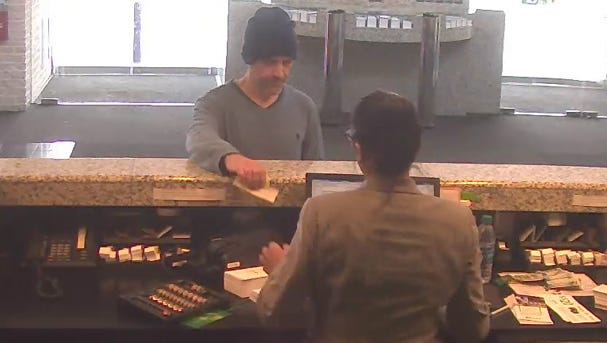 Police are searching for this man, who's accused of robbing a bank Wednesday in Cinnaminson.