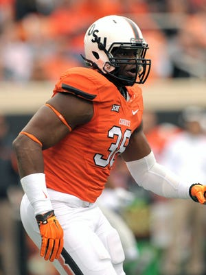 Oklahoma State defensive end Emmanuel Ogbah (38) projects as an NFL first-round draft pick.