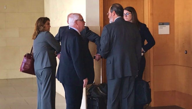 TRMC lawyer Riley Walter and HCCA lawyer Marc Levinson meet outside the courtroom.