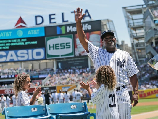 Former New York Yankees Tim Raines waves to fans during Old-Timers' Day at Yankee Stadium, Sunday, June 25, 2017, in New York. (AP Photo/Seth Wenig)