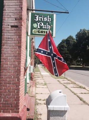 The confederate flag flies outside of Mullen's Irish Pub in Edgar.