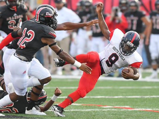 South Panola High School running back Quin Bradford (9) is upended against Brandon High School  during game action Friday, August 25th, 2017 in Brandon, MS.(Bob Smith-For the Clarion Ledger)