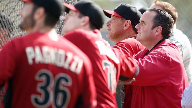 Arizona Diamondbacks President & CEO Derrick Hall watches the catchers hit during spring training batting practice on Tuesday, Feb. 24, 2015 in Scottsdale, AZ.