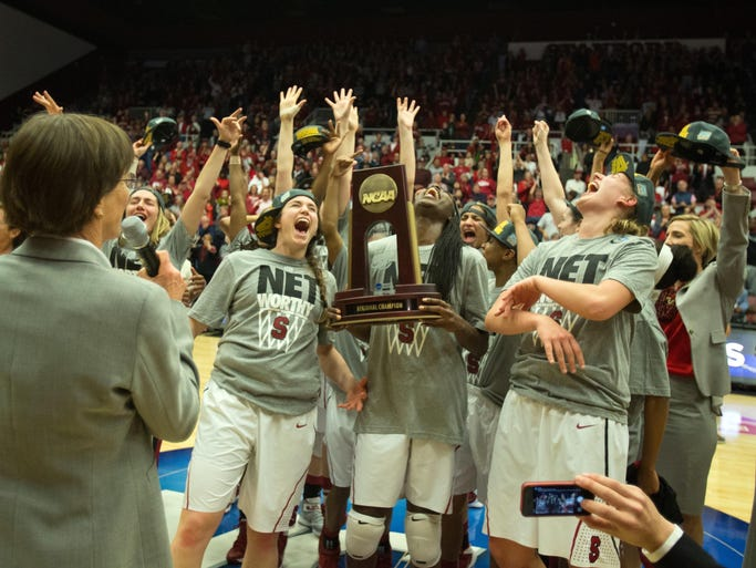 Stanford Cardinal celebrate after the win against the North Carolina Tar Heels in the finals of the Stanford regional in the 2014 NCAA Tournament at at Maples Pavilion.