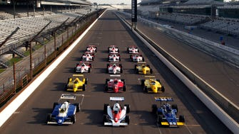 The 15 cars owner by Penske Racing who won of the Indianapolis 500 auto race at displayed on the main straight at the Indianapolis Motor Speedway in Indianapolis, Tuesday, May 31, 2011.  The cars, lined up in order from the earliest win, with the Mark Donohue, No. 66 car from 1972, the 1979 No. 9 car of Rick Mears and the 1981 No. 3 car of Bobby Unser, leading the display.