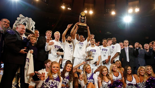 TCU players pose with the trophy after defeating Georgia Tech in the NIT final.