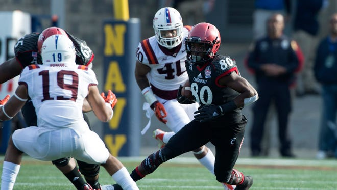 Cincinnati Bearcats wide receiver Alex Chisum (80) runs with the ball after the catch during the first quarter of the 2014 Military Bowl against the Virginia Tech Hokies at Navy-Marine Corps Memorial Stadium.