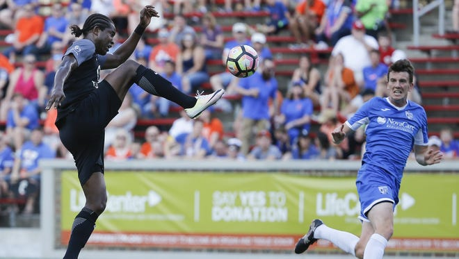 FC Cincinnati striker Djiby Fall (9) traps the ball in the penalty box in the first half during the Lamar Hunt US Open Cup game between AFC Cleveland and FC Cincinnati, Wednesday, May 17, 2017.