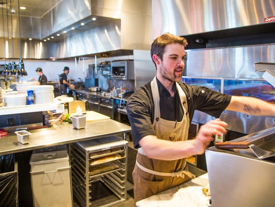 Sous chef Parker Rosbrook works in the kitchen at Mora
