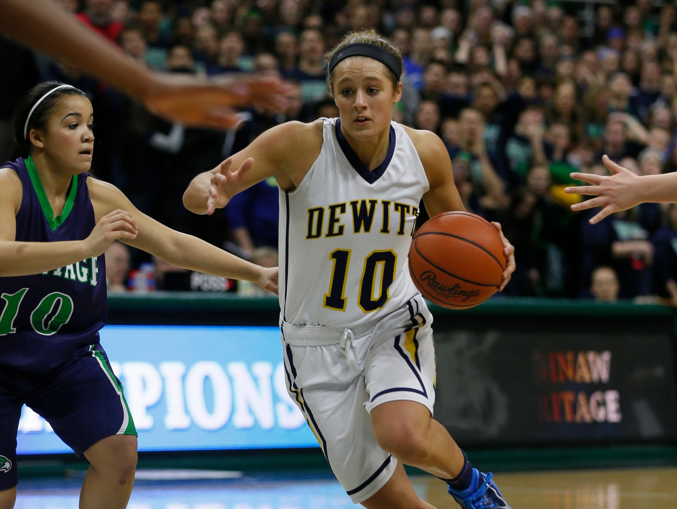 Dewitt's Claudia Reid drive to the basket in the second half of their 44-36 win over Saginaw Heritage in MHSAA Class A semi final game on Friday, March 19, 2015 in East Lansing.