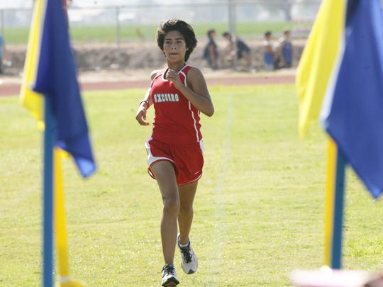 Jocelyn Caro of Socorro won the girls cross country race in 18 minutes, 57 seconds, beating second-place Regina Maquez of Santa Teresa by 31 seconds during the Del Valle/Hanks Invitational in 2012 at Del Valle High School.