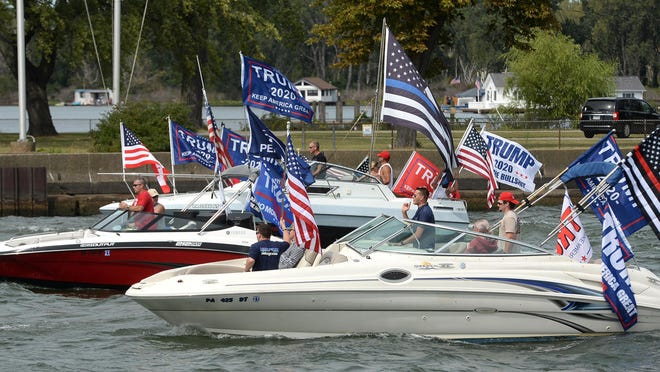 Participants in a boat parade in support of President Donald Trump enter Presque Isle Bay in Erie on Sunday. The parade started at the Presque Isle Lighthouse and ended at Dobbins Landing.