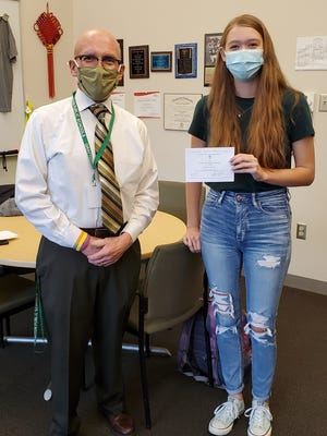 Grafton High School Principal James Pignataro, left, stands with GHS student Juliana Kallio who was named a commended student in the 2021 National Merit Scholarship Program.