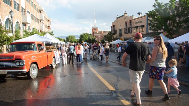 Members of the St. George community commemorate the first George Streetfest Friday, June 5, 2015.