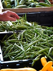 Fresh cucumbers, green beans and squash are popular sellers at Nashville Farmers' Market.
