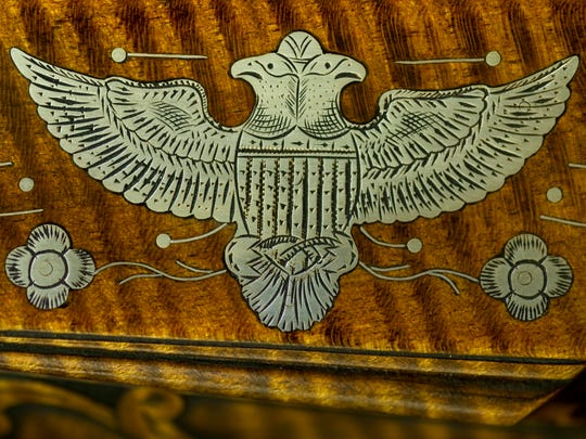 The silver-inlayed double-headed eagle is hand-drawn and hand-engraved by Marvin J. Kemper.