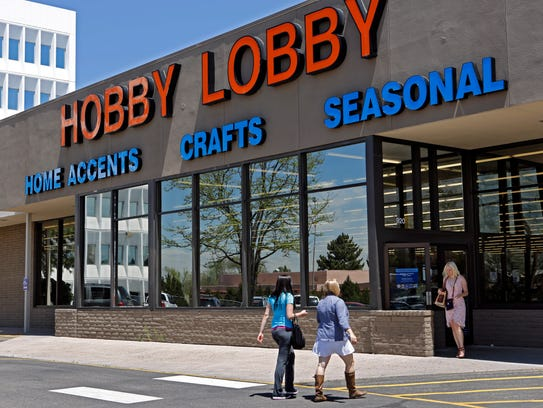 Customers are pictured visiting a Hobby Lobby store.