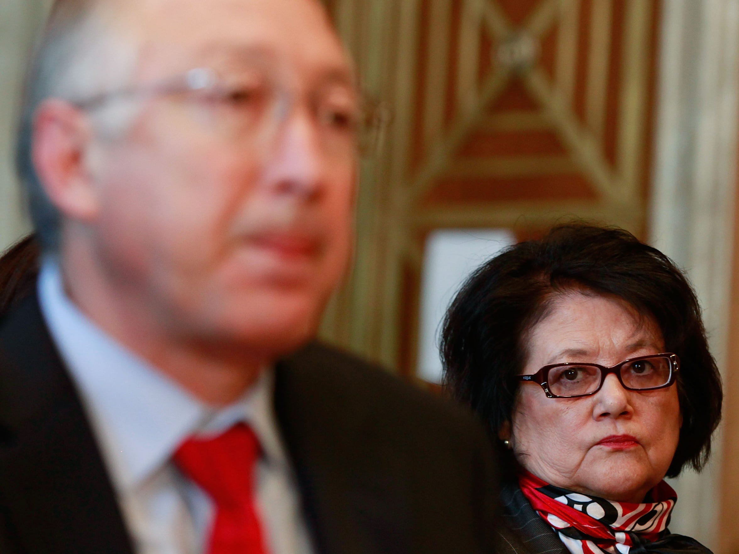 Elouise Cobell, right, watches as Interior Secretary