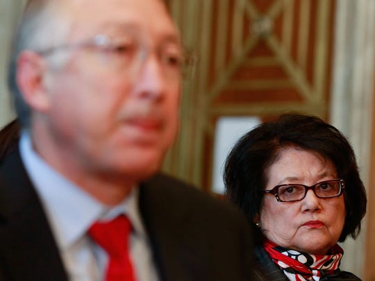 Elouise Cobell, right, watches as Interior Secretary Ken Salazar testifies during a Senate Indian Affairs Committee hearing in 2009. The committee was hearing testimony on the proposed settlement in a class-action lawsuit Native American representatives filed against the United States.