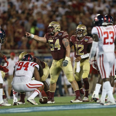 FSU's Alec Eberle points out the defense for his teammates