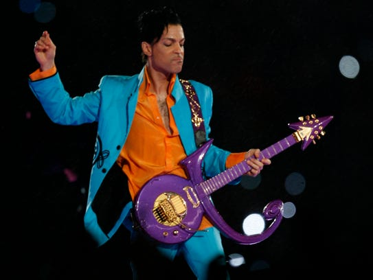 Prince performs at halftime of Super Bowl XLI in Miami