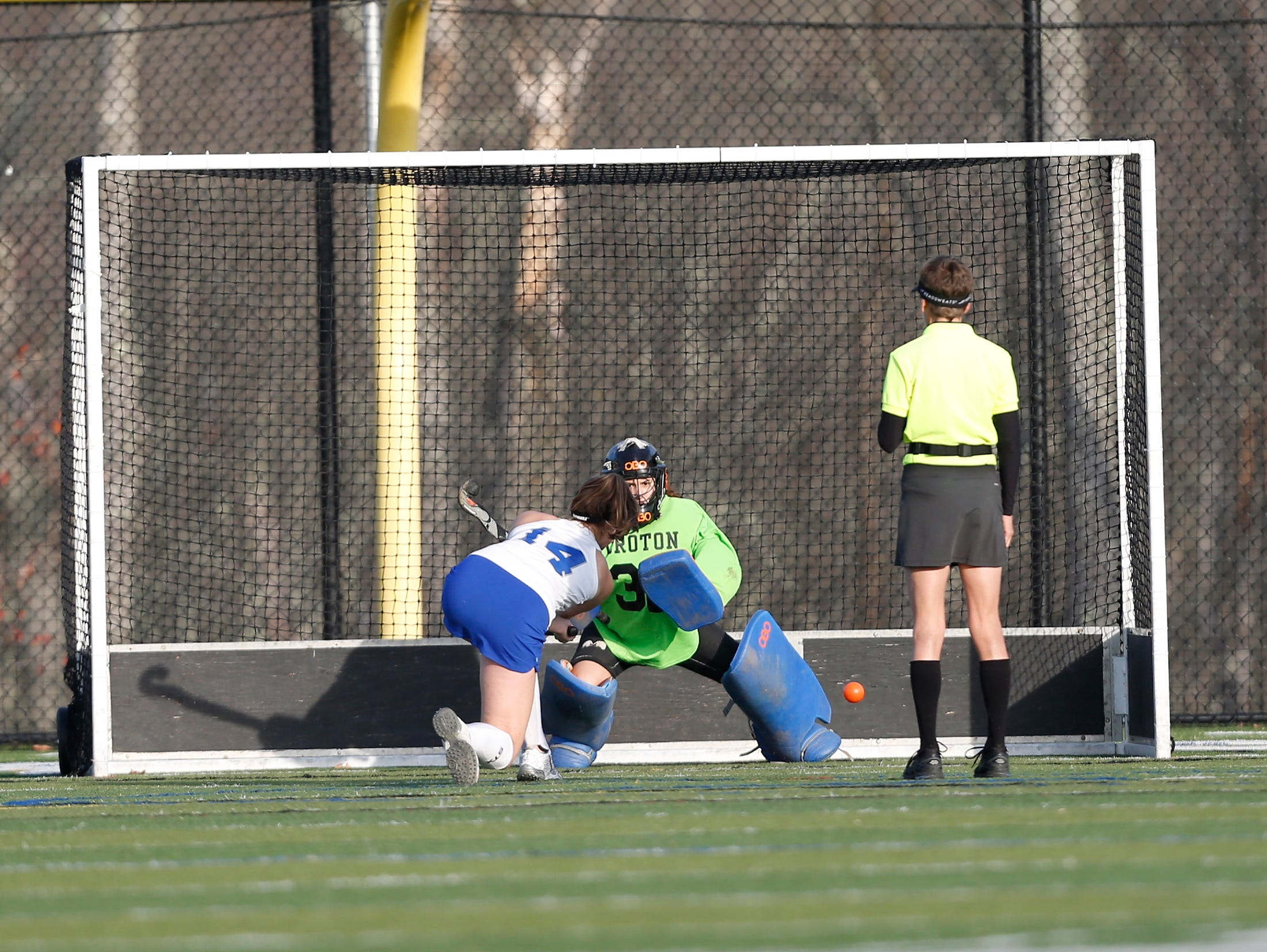 Bronxville's Hadley Barr (14) puts a penalty shot past Croton golie Maddie Camilleri (32) during their 7-1 win over Croton in the Class C field hockey sectiion finals at Brewster High School on Tuesday, November 1, 2016.