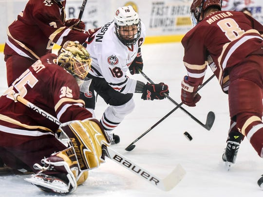St. Cloud State forward Judd Peterson can't get the puck past Boston College goalie Ryan Edquist and defender Jesper Mattila during the first period  Friday, Oct. 20, at the Herb Brooks National Hockey Center.
