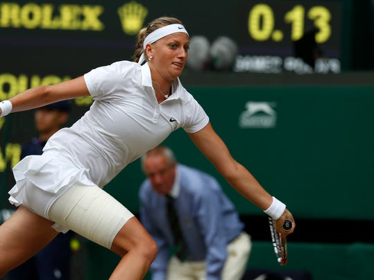 Petra Kvitova of the Czech Republic plays a return to Eugenie Bouchard of Canada during the women's singles final at the All England Lawn Tennis Championships in Wimbledon, London, Saturday July 5, 2014. (AP Photo/Sang Tan)