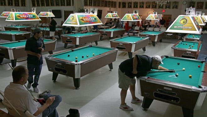 """Hundreds of pool players compete Thursday, June 21, 2018, during the 5th Annual """"Junior Norris"""" Memorial Shootout at the Maskat Shrine Center. The tournament started on Wednesday and ends on Sunday."""