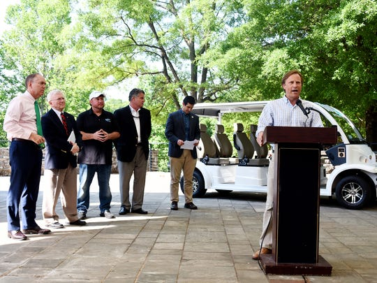 Stephen Gray of Rogers EV speaks at a press conference announcing the Hop-In ride service in downtown Greenville on Thursday, May 10, 2018. The service will use a low-speed electric vehilce to transport passengers from one side of downtown to another.