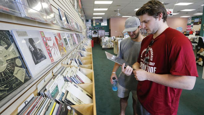 Adam Box and Mason Campbell shop for music at Oz Music in Tuscaloosa Friday, Sept. 27, 2019.