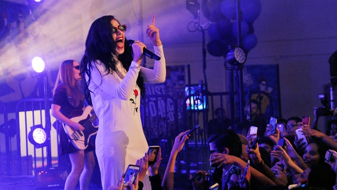 Charli XCX performs to high school students during the Just Dance Homecoming at Aspire Pacific Academy on Wednesday, Oct. 22, 2014, in Huntington Park, Calif. The event celebrated the launch of the video game Just Dance 2015.