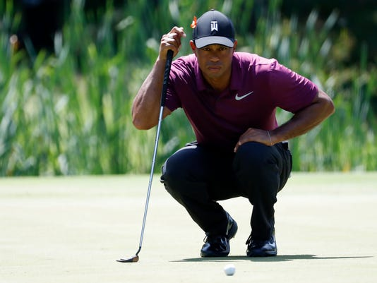 2018-06-29-tiger-woods-quicken