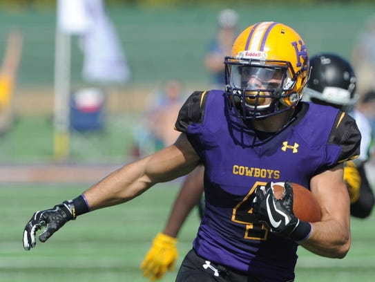 HSU's Matthew Sandoval carries the ball in the Cowboys