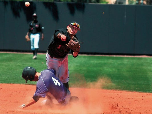 Jaime Guzman/For the Sun-News   New Mexico State second baseman Aaron Duran turns the front end of a double play Sunday afternoon at Presley Askew Field against Grand Canyon University.