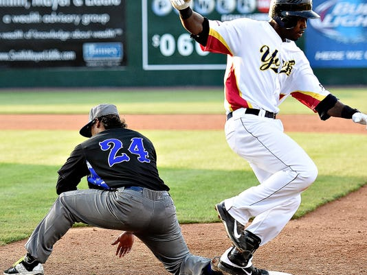 Sugar Land's Delwyn Young, left, catches the ball at first to force out York's Andres Perez on Tuesday night at Santander Stadium in York. Sugar Land won the game, 9-6. Dawn J. Sagert - dsagert@yorkdispatch.com
