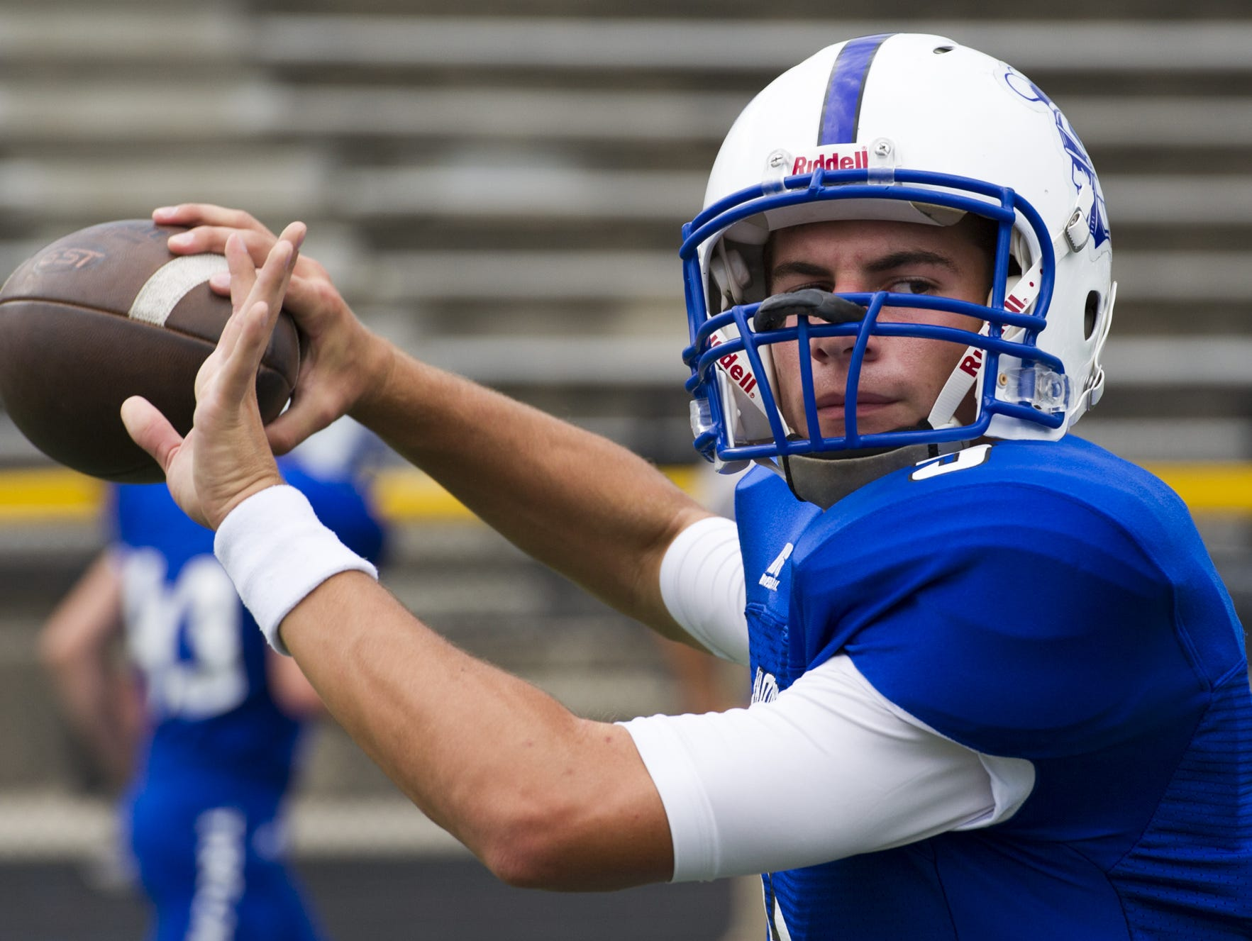 Bishop Chatard High School senior Lewis Dilts (9) warms up on the field during pre-game activities of a high school varsity football game at Lawrence Central High School, Friday, September 4, 2015, in Indianapolis.